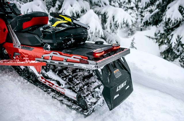 Rider jumping on a Lynx snowmobile