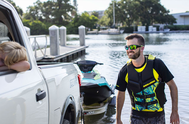 Man wearing blue, long-sleeve Sea-Doo rash guard